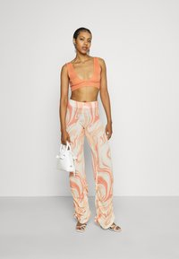 Jaded London - RUCHED JOGGERS SWIRL - Trousers - orange/off-white - 1