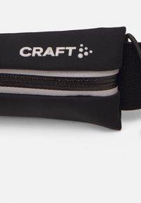 Craft - CHARGE BELT UNISEX - Vyölaukku - black - 4