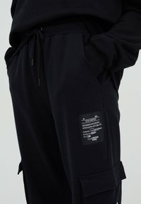 PULL&BEAR - Tracksuit bottoms - black - 6