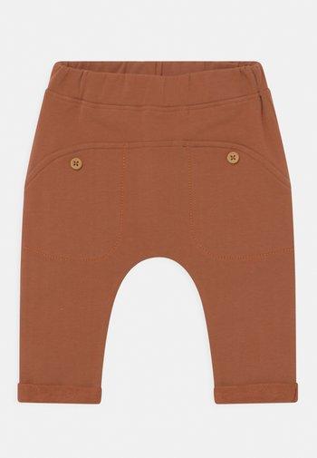GO UNISEX - Trousers - ochre