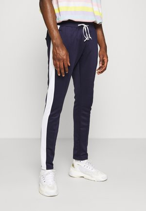 KING - Tracksuit bottoms - dark navy/white