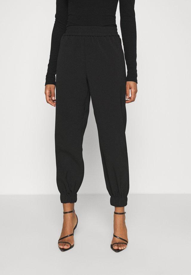AIDEN TROUSER - Teplákové kalhoty - black