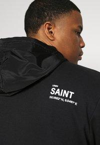 URBN SAINT - USELKON - Zip-up hoodie - black - 4