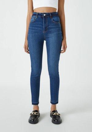Jeansy Skinny Fit - stone blue denim