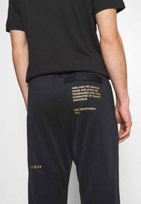 Nike Sportswear - PANT - Tracksuit bottoms - black/gold - 6