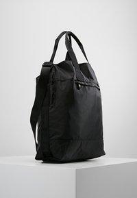 Casall - TOTE BAG - Across body bag - black - 3