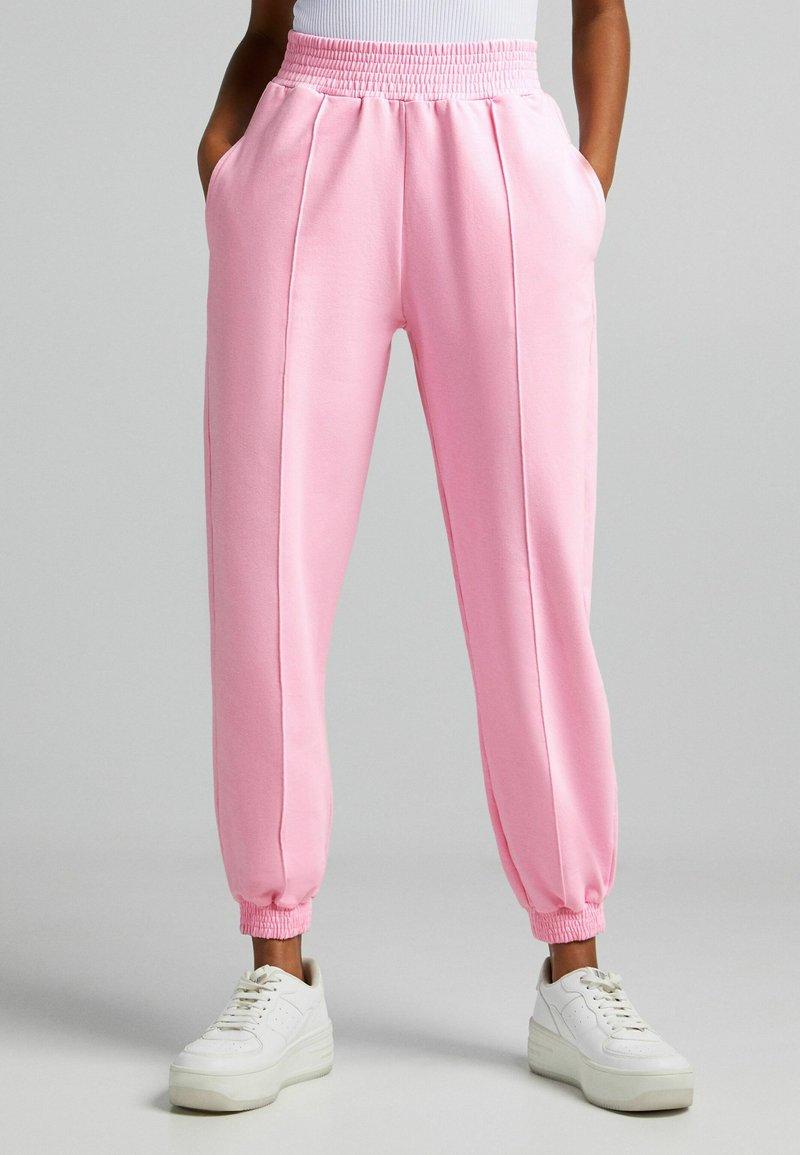 Bershka - Tracksuit bottoms - pink