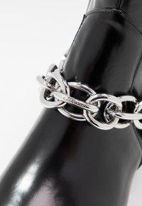 Calvin Klein - PALMMA - Cowboy/biker ankle boot - black - 2