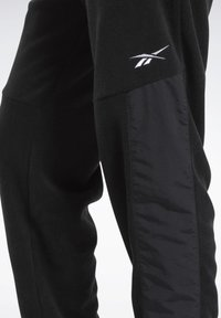 Reebok - MYT WARM-UP JOGGERS - Tracksuit bottoms - black - 5