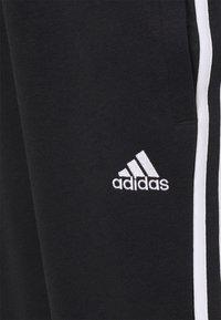 adidas Performance - MATERNITY - Tracksuit bottoms - black/white - 2
