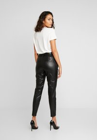 ONLY - ONLPOPTRASH YO EASY PAPERBAG - Trousers - black - 3