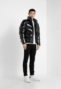 Peak Performance Urban - APRES JACKET - Down jacket - black - 1