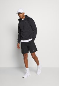 Under Armour - RIVAL HOODIE - Hættetrøjer - black/onyx white - 1
