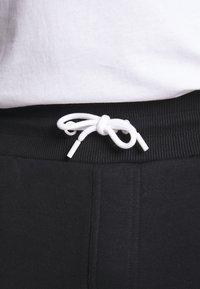 Calvin Klein - LOGO STRIPE  - Tracksuit bottoms - black - 5