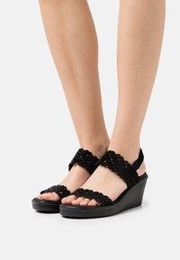 Skechers - RUMBLE ON - Platform sandals - black - 0