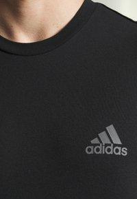 adidas Performance - Long sleeved top - black - 5