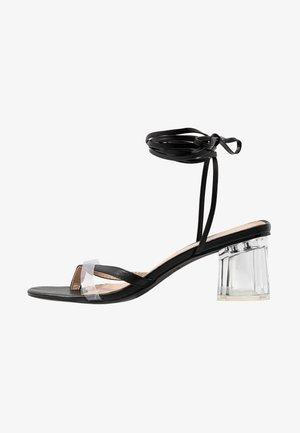 DESIRE - Sandals - clear/black