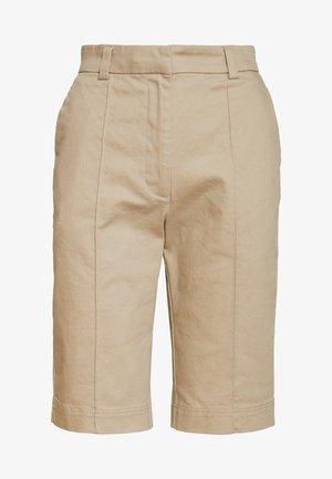 TAMIK - Shorts - beige