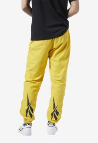 Reebok Classic - CLASSICS VECTOR TRACK PANTS - Tracksuit bottoms - toxic yellow - 2