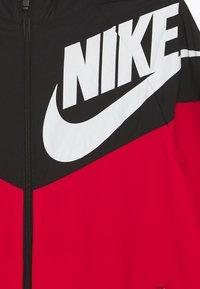 Nike Sportswear - WINDRUNNER - Training jacket - black/university red/white - 2