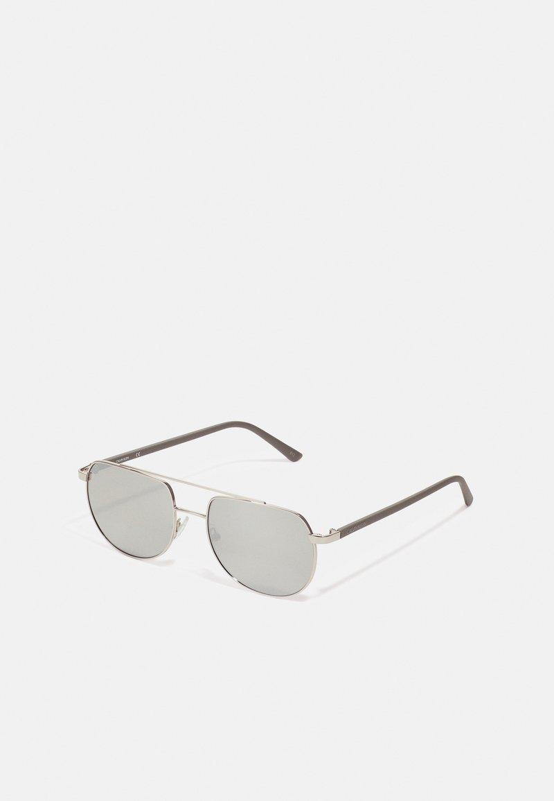 Calvin Klein - UNISEX - Sunglasses - silver-coloured/grey