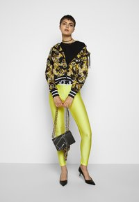 Versace Jeans Couture - Leggings - Trousers - verde mela - 1