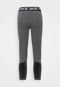 Nike Performance - CROP - Leggings - black/white - 6
