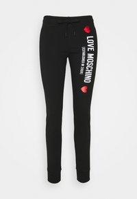 Love Moschino - Spodnie treningowe - black - 4
