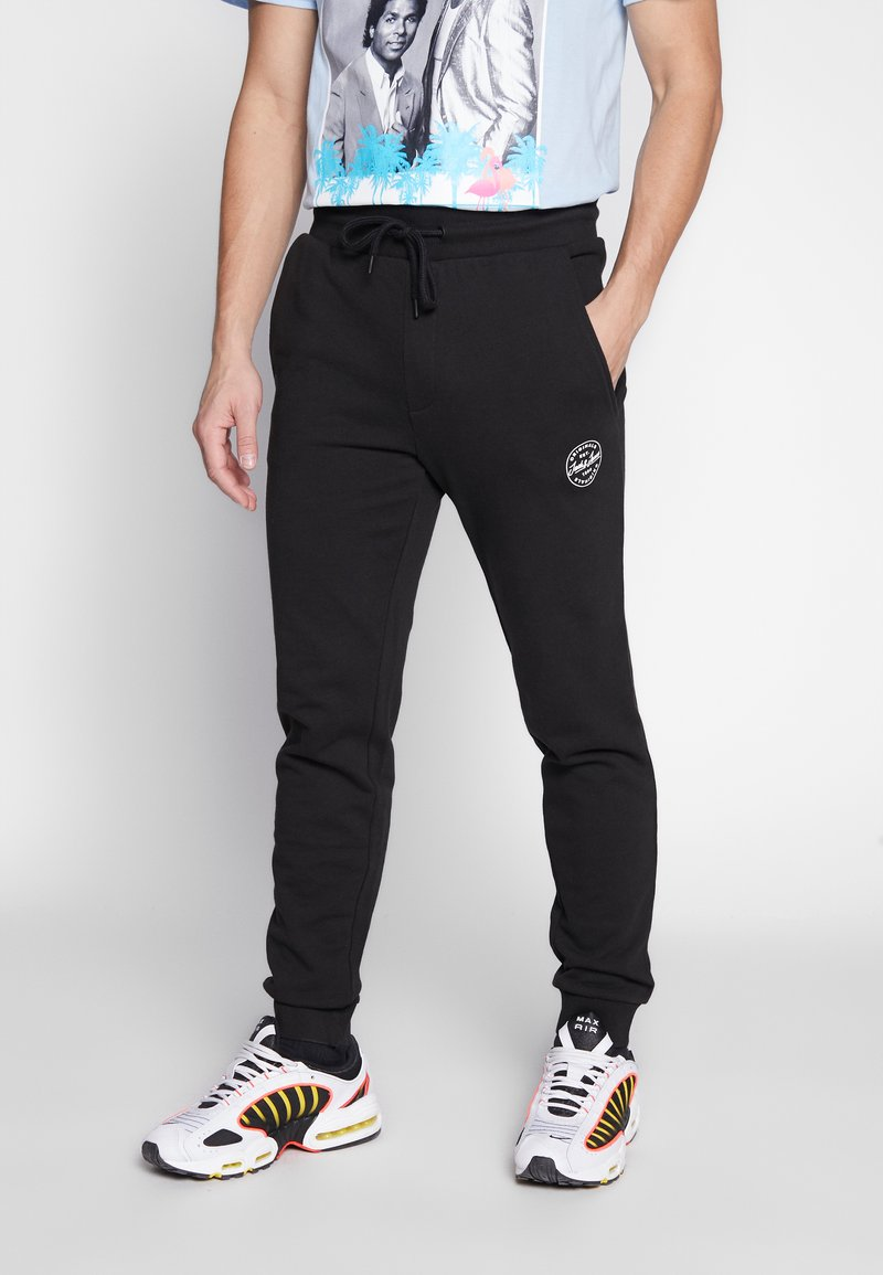 Jack & Jones - JJIGORDON  - Tracksuit bottoms - black