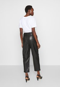 Filippa K - KARLIE TROUSER - Leather trousers - black - 2