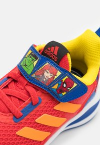 adidas Performance - FORTARUN SUPERHERO UNISEX - Neutral running shoes - vivid red/team royal blue/footwear white - 5