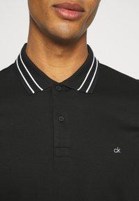 Calvin Klein Tailored - LIQUID TOUCH TIPPING SLIM - Polo shirt - black - 5