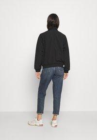 Carhartt WIP - KEYSTONE REVERSIBLE JACKET - Winter jacket - black - 2