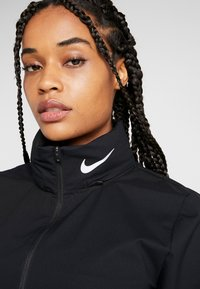 Nike Performance - Sports jacket - black/reflective silver - 6