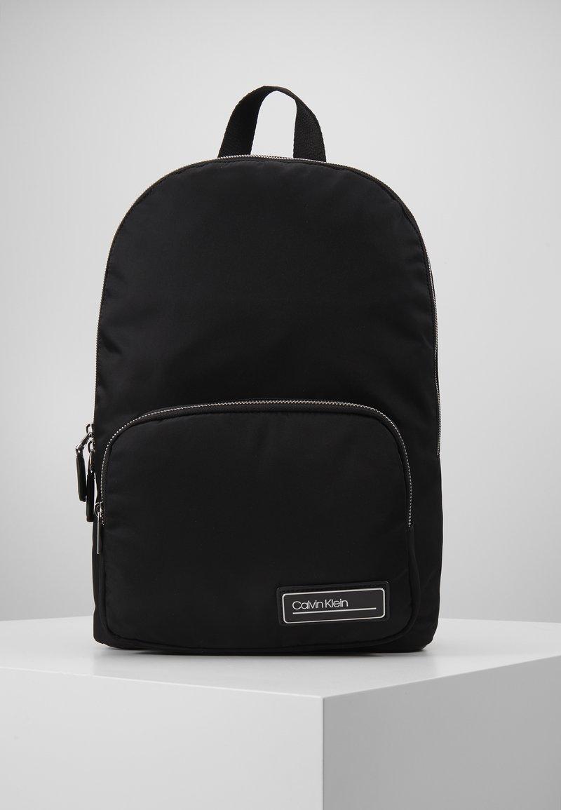 Calvin Klein - PRIMARY ROUND BACKPACK - Rucksack - black