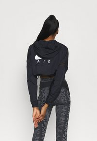 Nike Performance - AIR JACKET CROP - Outdoor jacket - black/reflective silver - 2