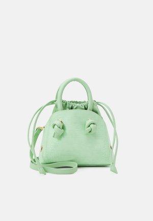PCLAVENDA CROSS BODY KEY - Handbag - pastelgreen/gold-coloured