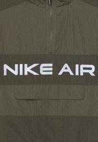 Nike Sportswear - AIR UNLINED ANORAK - Chaqueta de entretiempo - medium olive/cargo khaki - 2
