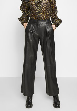TOXIC - Leather trousers - black