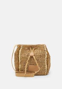 RILEY - Handbag - camel