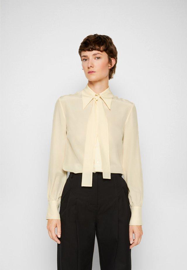 TIE NECK SHIRT - Button-down blouse - butter yellow