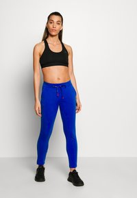 Champion - SLIM PANTS - Joggebukse - blue - 1
