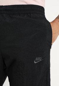 Nike Sportswear - WOVEN PANT - Tracksuit bottoms - black/anthracite/dark grey - 3
