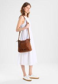 Tamaris - ULLA CROSSBODY BAG - Across body bag - brown - 1