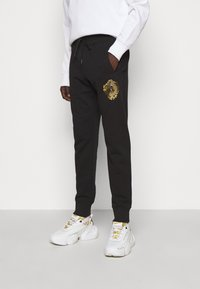 Versace Jeans Couture - Tracksuit bottoms - mottled olive - 0
