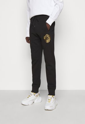 Tracksuit bottoms - mottled olive