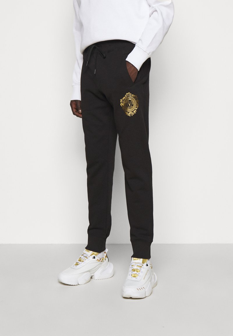 Versace Jeans Couture - Tracksuit bottoms - mottled olive