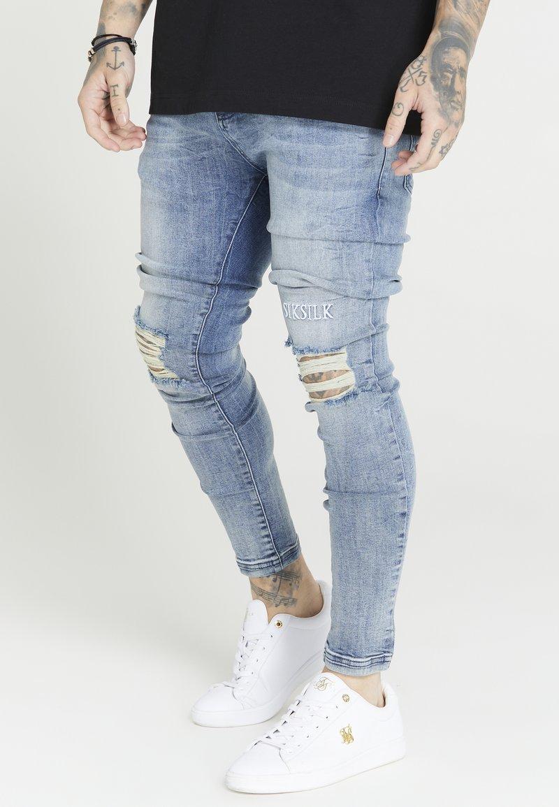 SIKSILK - RAW HEM BURST KNEE - Jeans Skinny Fit - rustic blue wash