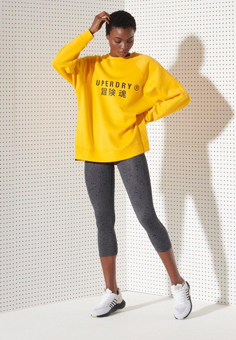 Women LOGO CAPRI LEGGINGS - Leggings