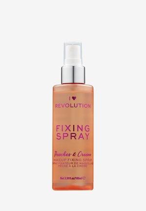 I HEART REVOLUTION PEACHES & CREAM FIXING SPRAY - Setting spray & powder - clear